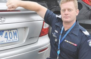 Ballan's OIC Sgt Michael Kearnes is urging residents to have the screws in their vehicle number plates changed on Saturday 25 March in Ballan. Photo – Helen Tatchell