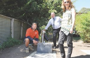 Phil Burnell (SSA Team Leader), Pat Toohey (MSC) with a septic system recently completed on Noelle Shader's property Photo – Helen Tatchell