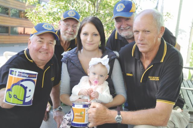 MAKE IT A GOOD FRIDAY - Little Emeliah Roberts with mum Tjanna and Bacchus Marsh Lions club members who are raising money for the Royal Children's Hospital Good Friday Appeal (L-R) David Atterbury, Tim van de Poel, Ralph Fletcher and Terry Sytema. Photo – Helen Tatchell