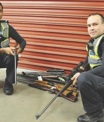 Operation gun safe – Constable Andy Goel and James Peterson from Bacchus Marsh police with confiscated weapons. Photo – Helen Tatchell