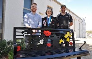 President Bacchus Marsh RSL Cherrison Lawton at the memorial seat that depicts Rupert Moon VC, Kathleen Rogers and William West MM and was designed by Mark Gilliland (left); constructed and donated by (right) Mick Horan (Rossco Engineering) Photo – Helen Tatchell