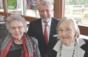 Pamela Broad and Heather Linsdell, with Andrew Freeman (CEO DjHS), have each been volunteers for 55-years. Photo – Helen Tatchell
