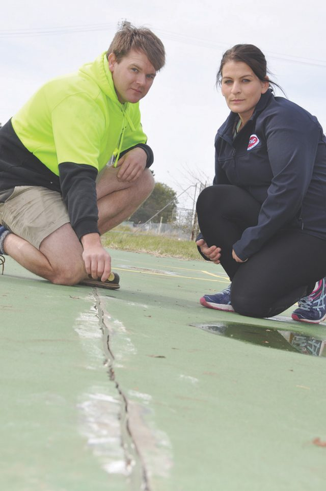 Reserve Chairperson Bill Smith and BFNC member Joanne Raffaele, show the cracks in the court that a $2 coin can fit in. Photo - Helen Tatchell
