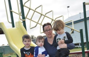 SAFER THAN IT WAS – Fundraiser facilitator for the Recreation Reseve Lori Conroy and three of her six children (L-R) Judd, Jordi and Jhett with the new bark, making the playground safer until a new facility is purchased. Photo – Helen Tatchell