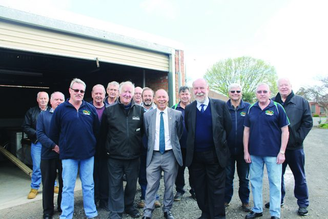(front) Bacchus Marsh Men's Shed President Alec McQuie, Vic Men's Shed Association member Bob Forde, Member for Buninyong Geoff Howard and Don Nardella (Member for Melton) with members at the announcement of new funding. Photo – Jessica Howard