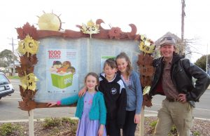 Local sculptor Paul Blizzard, pictured with his children (L-R) Indya, Jarra and Sage, designed and crafted an autumn leaf and literacy themed notice board outside the Ballan Library. Photo – Jane Gardner