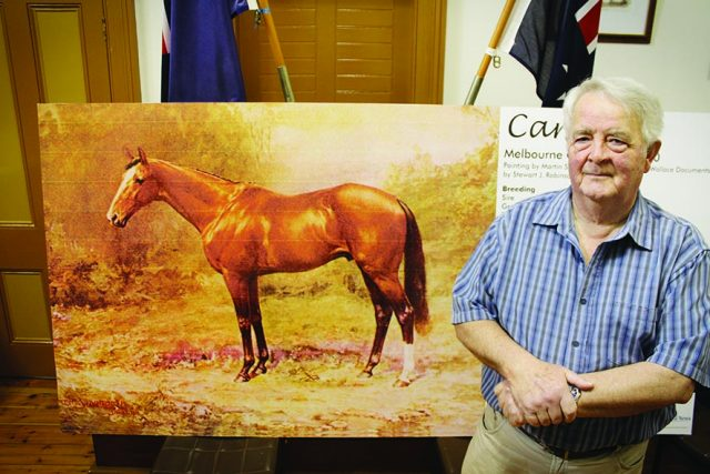 Richard Biden with Carbine's display (one of four) for the Emirates Melbourne Cup Tour in Ballan. Photo Jessica Howard