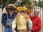 Marigold (centre) will be situated around the town promoting the Flower and Garden Show and is pictured with another decorative scarecrow friend and Kate Tubbs (right). Photo – Jock Taylor
