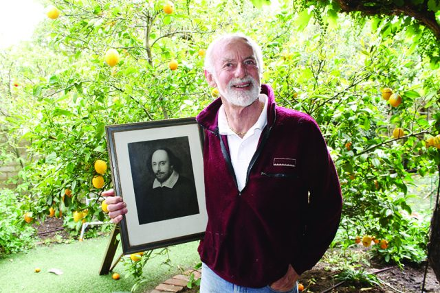 Geoff Camm with a framed picture of William Shakespeare Photo – Jessica Howard