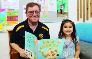 Rotary President Phil McBean and four-year-oldNevaeh, who received her Let's Read book at her 3.5-year-old check-up at Darley Early Years Hub. Photo – Jessica Howard
