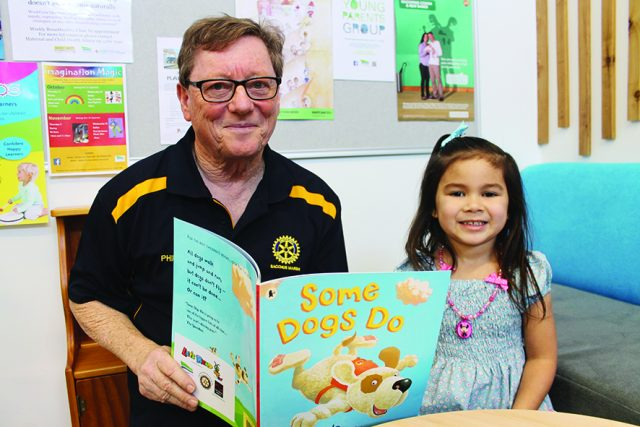Rotary President Phil McBean and four-year-old Nevaeh, who received her Let's Read book at her 3.5-year-old check-up at Darley Early Years Hub.   Photo – Jessica Howard