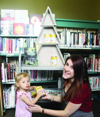 Sam from MSC Library Service at Ballan with Aliceand a can of donated food. Photo – Jessica Howard