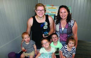 Playgroup mum's Jayne Oliver and Alissa Slatter with children (L-R) Leigh, Chloe, Owen and Emily, and the trophy the not-for profit group won (Ms Oliver holding). Photo – Jessica Howard