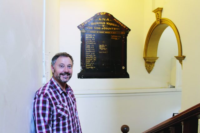 Bruce Carboon inside the ANA building with the Honour board Photo – Jessica Howard