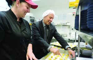 Member for Buninyong Geoff Howard helps bake some biscuits in the new kitchen. Photo – BDH&C