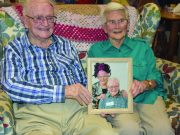 Tom and Lorraine Keene, now both deceased, with a photo of them both participating in the Priscilla High Tea event; with Lorraine coming up with the 2018 BAF theme shortly before her death. Photo – Leone Fabre.