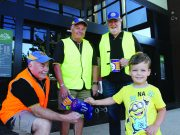 Pictured is four-year-old Riley donating to the Good Friday appeal with Bacchus Marsh Lions Club members Len Murfitt, Peter Gist and Ralph Fletcher. Photo – Jessica Howard