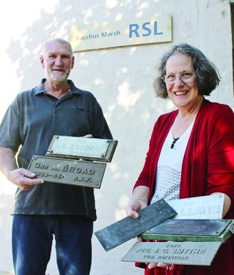 Bacchus Marsh RSL President Cherrison Lawton (right) withCentenary of Armistice Memorial Project sub-committee member, Terry Rosewarne hold a number of the old nameplaques. Photo – Jessica Howard