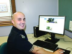 Bacchus Marsh Police Constable, Cameron Granland with the new Moorabool Eyewatch Facebook page, which was launched on March 5. Photo – Jessica Howard